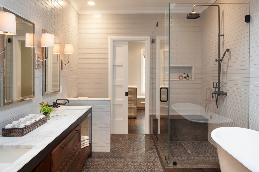 Bathroom - transitional master beige tile and subway tile mosaic tile floor bathroom idea in New York with recessed-panel cabinets, dark wood cabinets, beige walls, an undermount sink and a hinged shower door