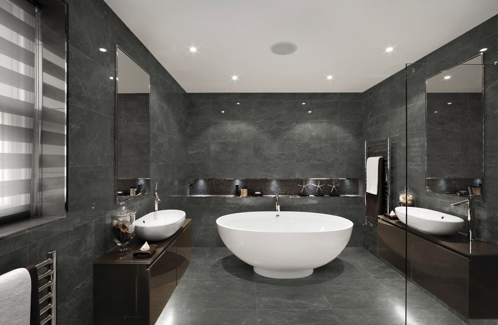 Inspiration for a contemporary master gray tile gray floor freestanding bathtub remodel in Philadelphia with flat-panel cabinets, brown cabinets, gray walls and a vessel sink