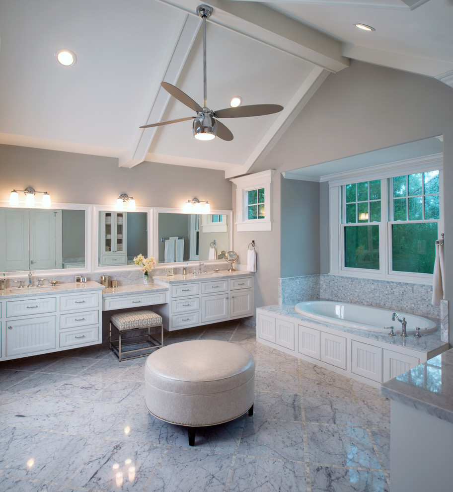 Large elegant master white tile and stone tile marble floor and gray floor bathroom photo in Houston with white cabinets, an undermount sink, beaded inset cabinets, marble countertops, gray walls, a two-piece toilet, a hinged shower door and white countertops