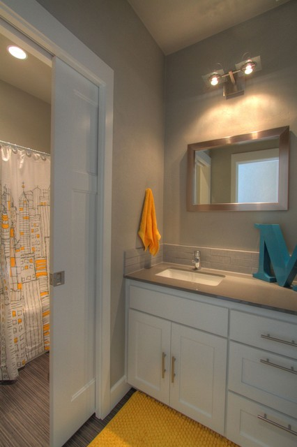 Urban loft style guest bathroom with yellow gray accents for Yellow bathroom accents
