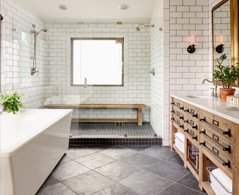 Inspiration for a large farmhouse master subway tile slate floor bathroom remodel in Charlotte with furniture-like cabinets, light wood cabinets, white walls, an undermount sink and a hinged shower door