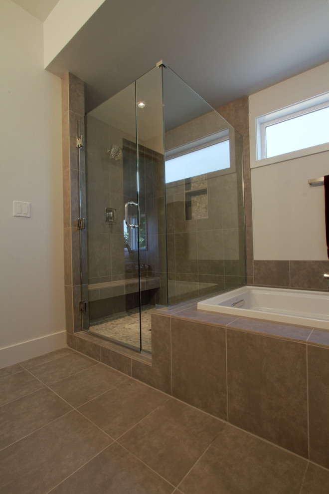Large minimalist master beige tile and porcelain tile porcelain tile bathroom photo in Portland with a vessel sink, flat-panel cabinets, dark wood cabinets, quartz countertops, a two-piece toilet and beige walls