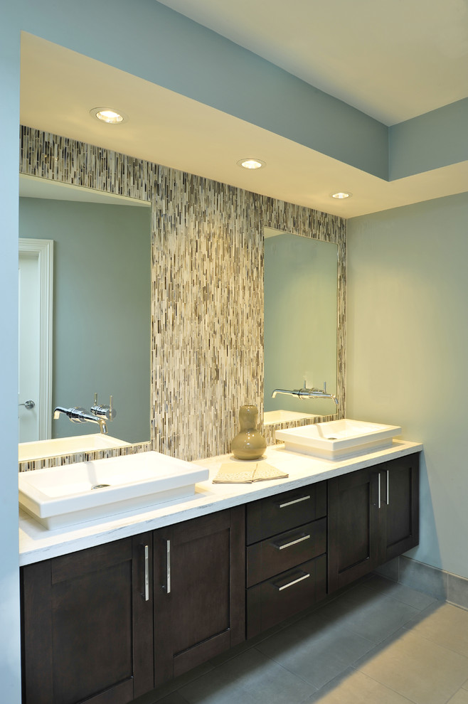 Inspiration for a transitional beige tile bathroom remodel in Nashville with a vessel sink, shaker cabinets and dark wood cabinets