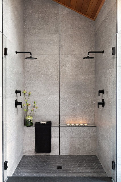 Photo of a large contemporary ensuite bathroom in Other with a double shower, grey tiles, grey walls, grey floors, a hinged door, flat-panel cabinets, medium wood cabinets, cement tiles, concrete flooring, a vessel sink and concrete worktops.