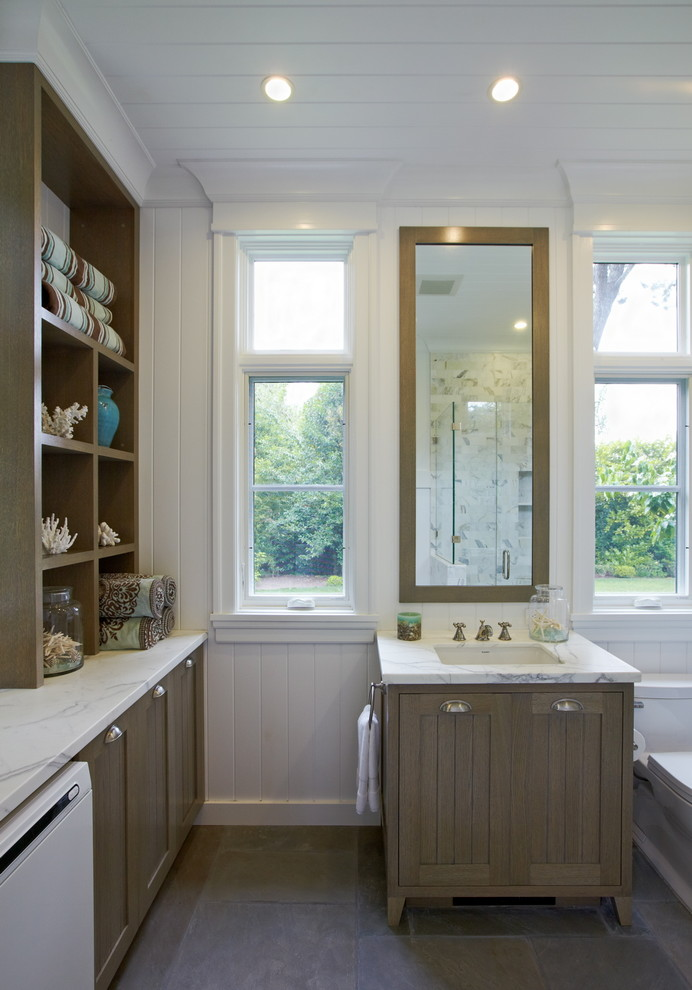 Ornate bathroom/laundry room photo in San Francisco with an undermount sink, shaker cabinets and medium tone wood cabinets