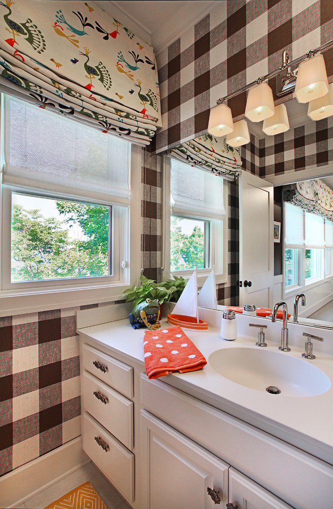Bathroom - traditional kids' bathroom idea in Grand Rapids with an integrated sink, raised-panel cabinets and white cabinets