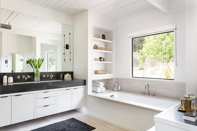 Design ideas for a contemporary bathroom in Los Angeles with flat-panel cabinets, an undermount tub, white walls and an undermount sink.