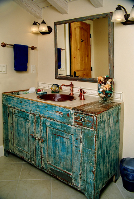 Cottage chic bathroom photo in Other with a drop-in sink and blue cabinets