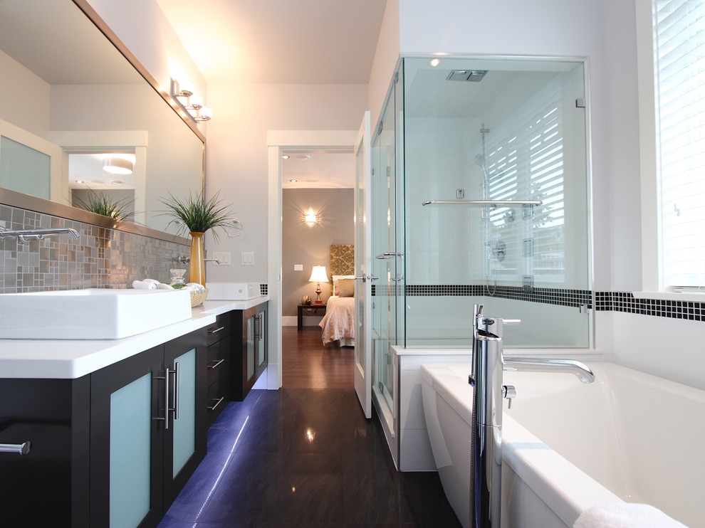 Example of a trendy freestanding bathtub design in Vancouver with white countertops