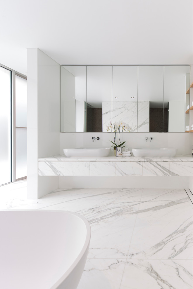 Example of a large minimalist master white tile and marble tile freestanding bathtub design in Sydney with a vessel sink, white walls, marble countertops and white countertops