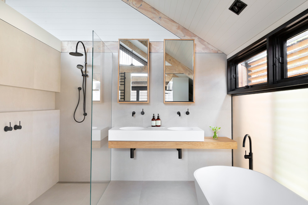 Danish bathroom photo in Melbourne with an integrated sink, wood countertops and beige countertops