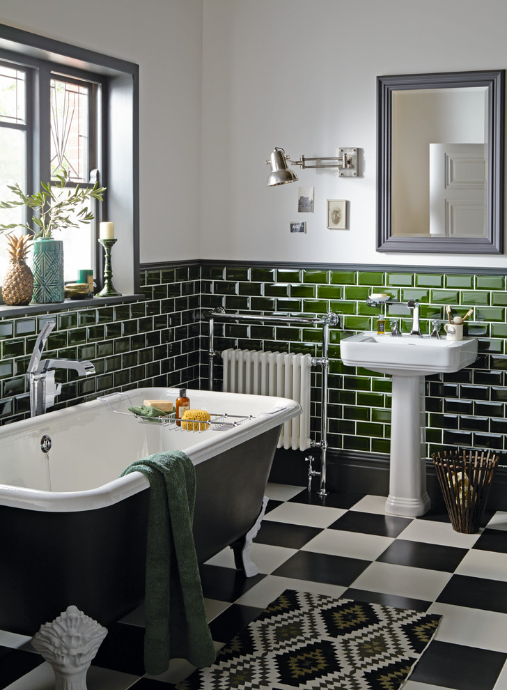 Claw-foot bathtub - mid-sized victorian green tile and subway tile multicolored floor claw-foot bathtub idea in West Midlands with gray walls and a console sink