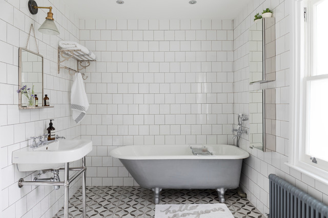 Inspiration for a mid-sized timeless white tile and ceramic tile ceramic floor freestanding bathtub remodel in London with white walls, glass-front cabinets and a console sink