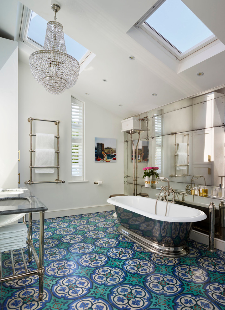 Inspiration for a victorian master multicolored tile turquoise floor freestanding bathtub remodel in London with white walls