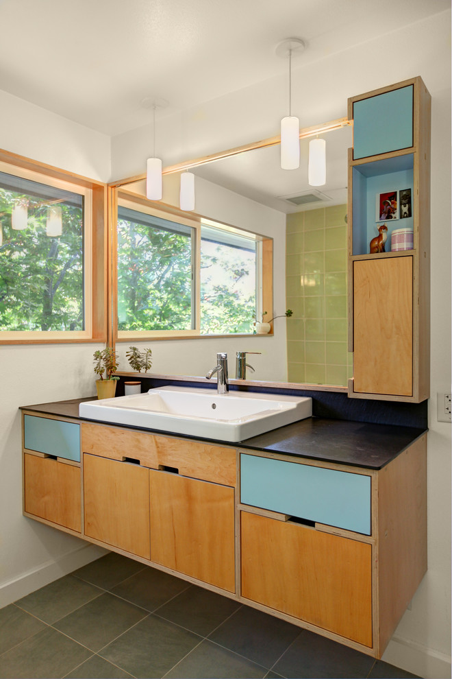 Bathroom - contemporary green tile bathroom idea in Seattle with a vessel sink, flat-panel cabinets and blue cabinets
