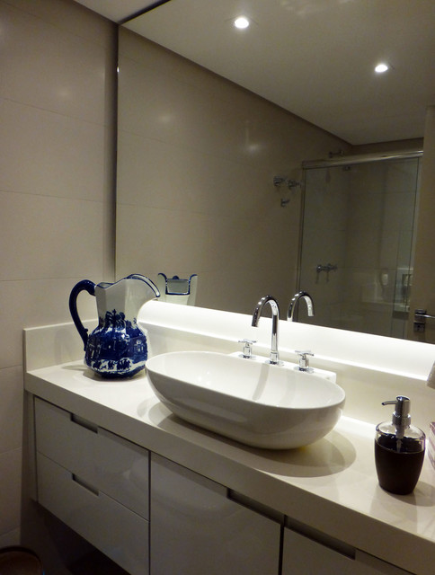 Mid-sized trendy beige tile and porcelain tile porcelain floor bathroom photo in Other with flat-panel cabinets, gray cabinets and engineered quartz countertops