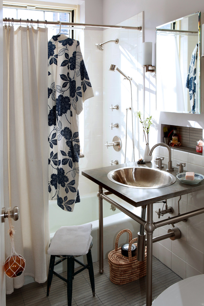 Inspiration for an eclectic bathroom remodel in New York with limestone countertops and a drop-in sink