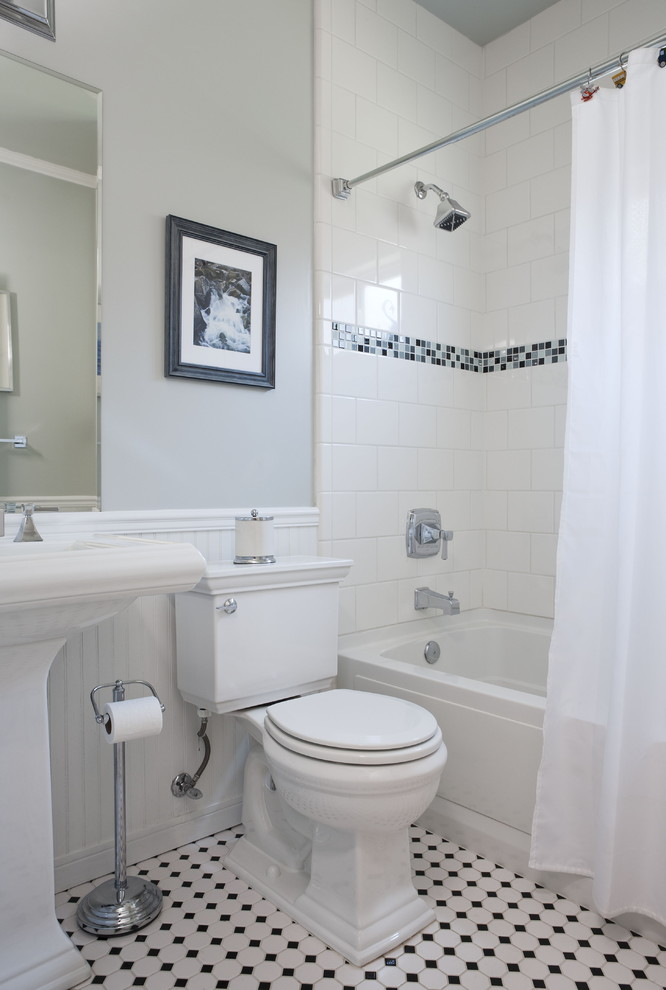 Example of a mid-sized classic mosaic tile ceramic floor bathroom design in San Francisco with a pedestal sink, a two-piece toilet and gray walls