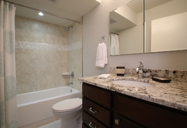 Vintage florida beach condo gets a transitional remodel for Florida bathroom ideas