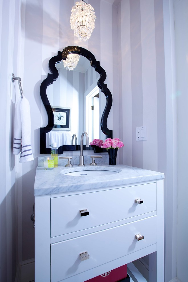Elegant bathroom photo in Sacramento with marble countertops and an undermount sink