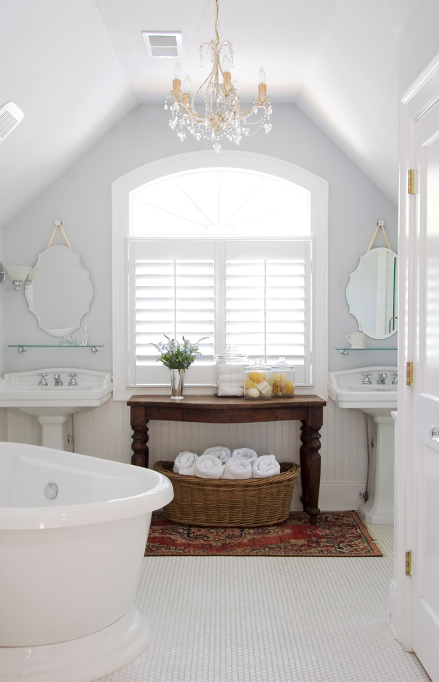 Inspiration for a timeless freestanding bathtub remodel in Atlanta with a pedestal sink