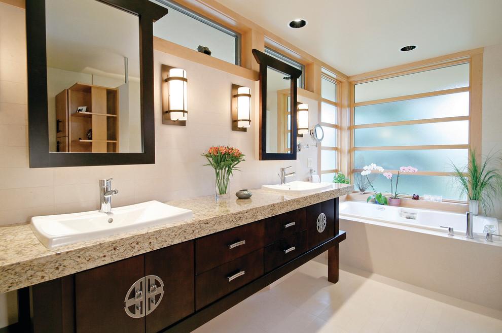 Example of a zen bathroom design in Milwaukee with a drop-in sink