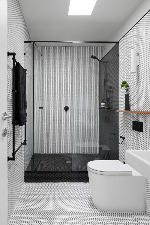 matte black multiple towel rack in black and white bathroom