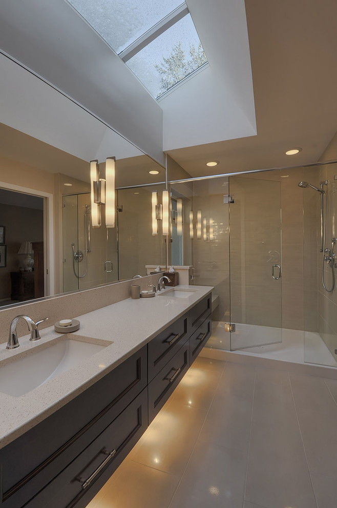 Bathroom - contemporary bathroom idea in Vancouver with solid surface countertops and an undermount sink