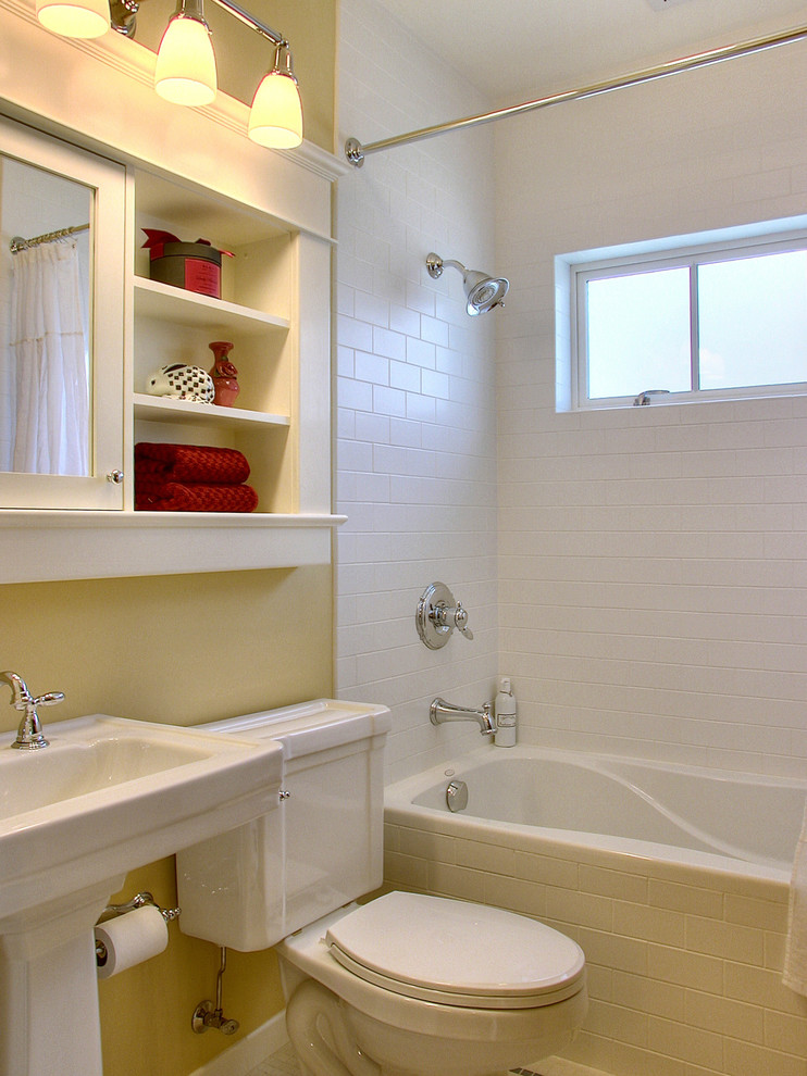 Example of a small classic subway tile bathroom design in Seattle with a pedestal sink