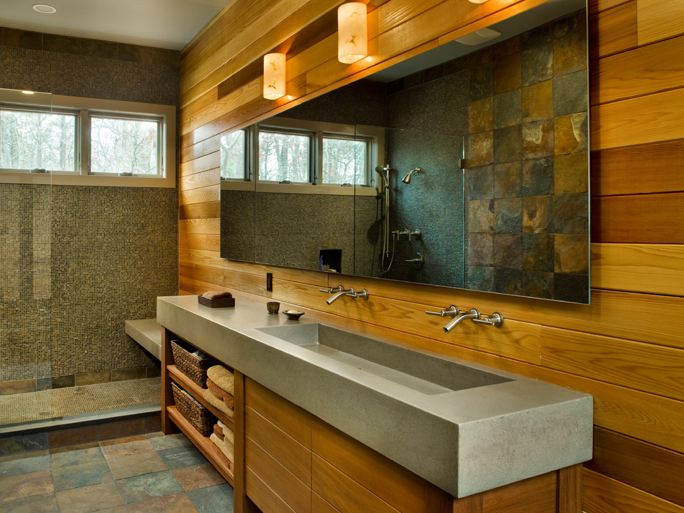 Trendy mosaic tile bathroom photo in New York with a trough sink, medium tone wood cabinets and concrete countertops