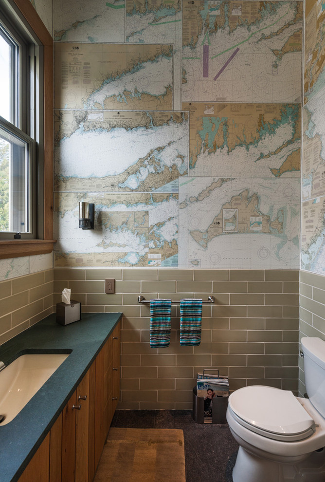 Example of a beach style subway tile bathroom design in New York with multicolored walls