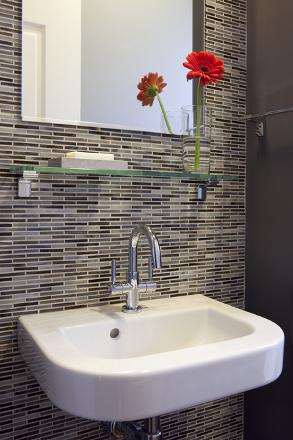 wall mounted sink w/ patterned tile contemporary bathroom