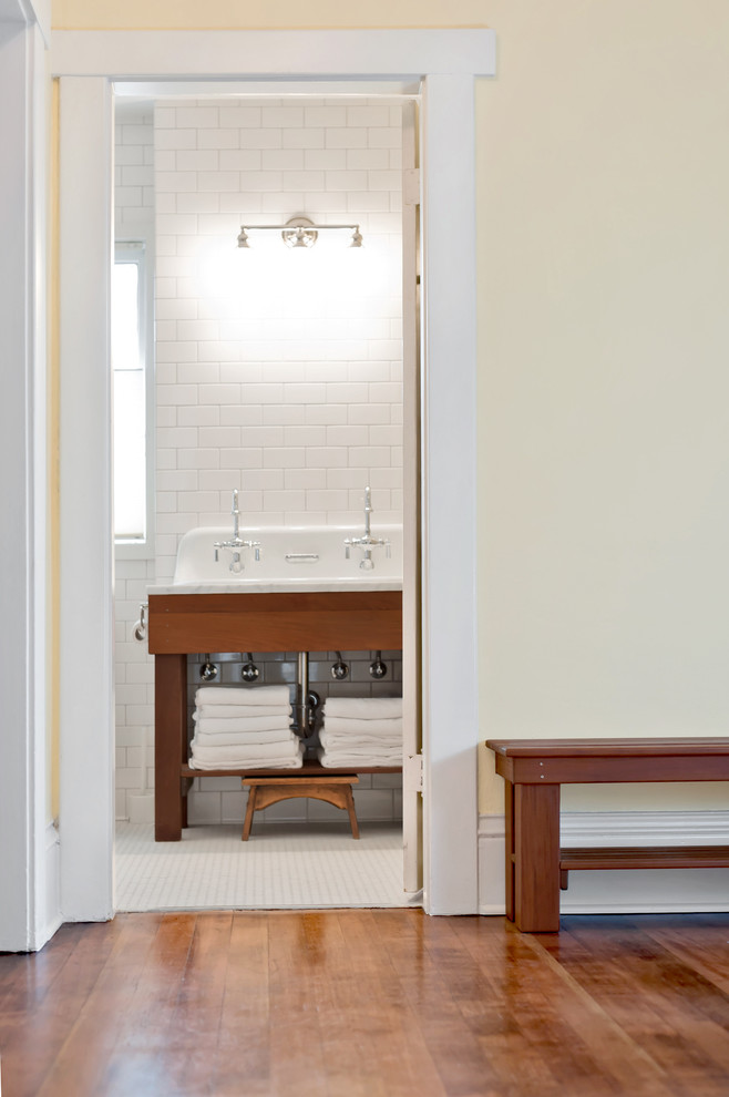 Example of a mid-sized farmhouse master white tile and subway tile dark wood floor and brown floor alcove shower design in Seattle with open cabinets, dark wood cabinets, yellow walls, a trough sink, marble countertops and gray countertops
