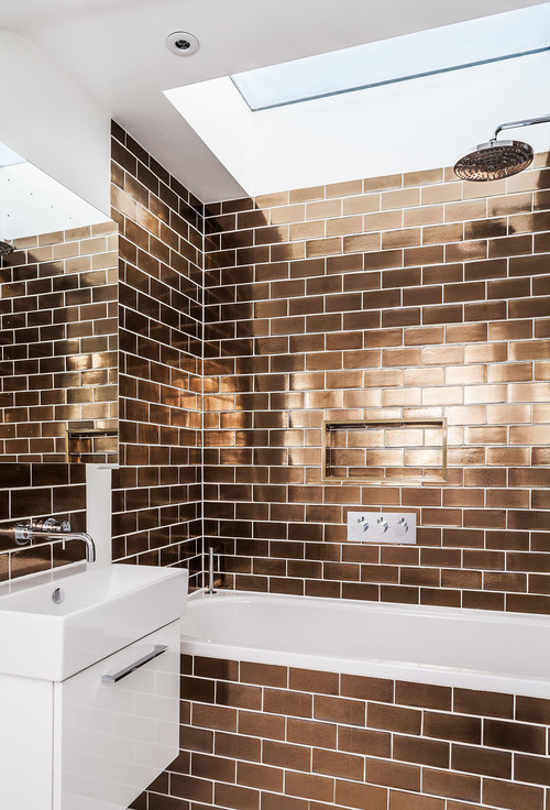 rose gold subway tile bathroom with skylight