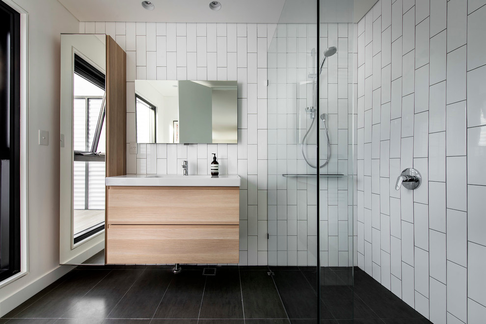 Inspiration for a mid-sized contemporary white tile and ceramic tile bathroom remodel in Perth with an integrated sink, flat-panel cabinets, white walls and light wood cabinets