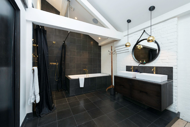 Large industrial bathroom in London with flat-panel cabinets, dark wood  cabinets, a