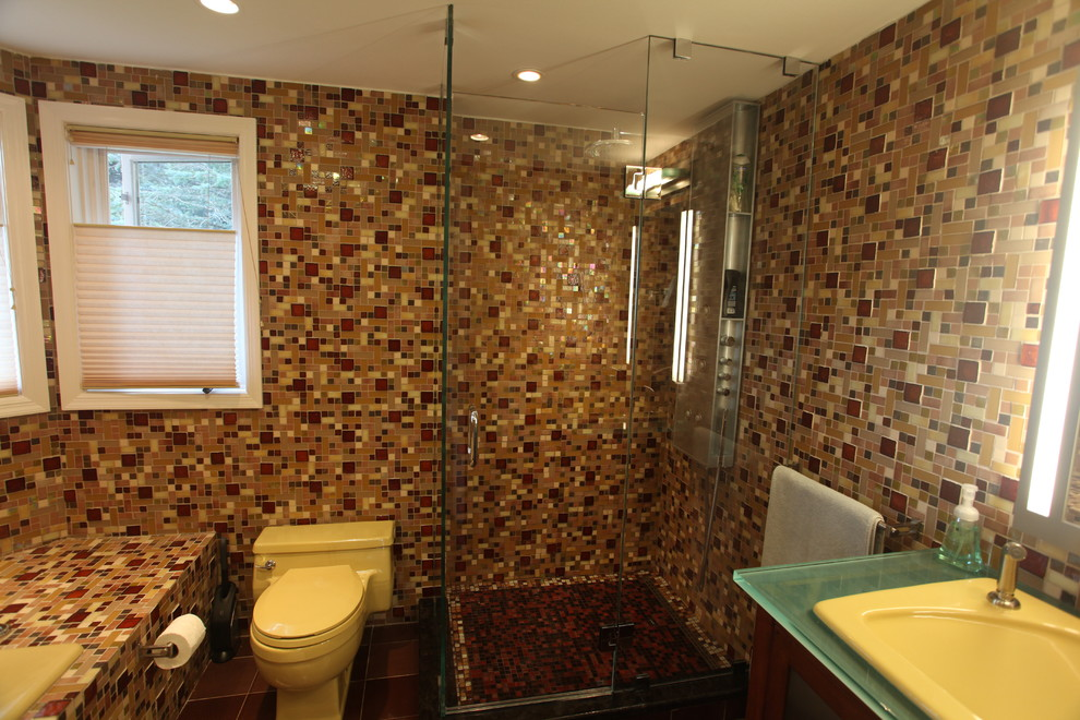 Bathroom - mid-sized contemporary 3/4 multicolored tile and mosaic tile porcelain tile and black floor bathroom idea in New York with glass-front cabinets, dark wood cabinets, multicolored walls, a drop-in sink, glass countertops and a hinged shower door