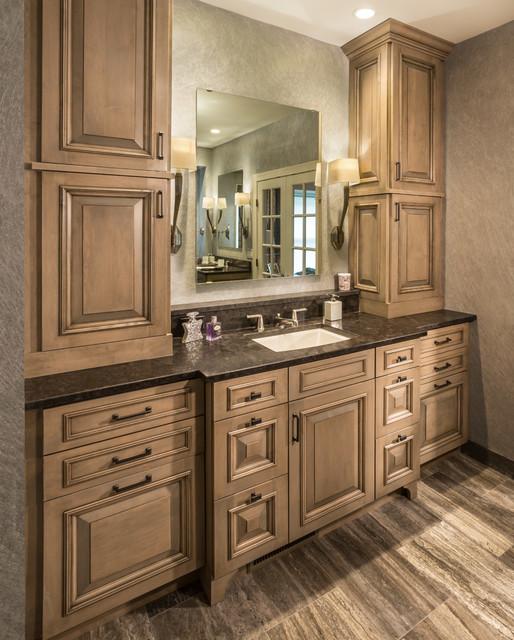 Warm tone raised panel vanity with abundant storage ...