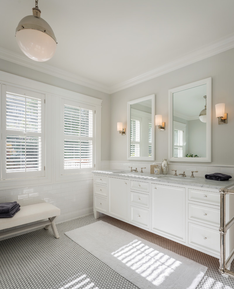 Example of a transitional white floor bathroom design in San Francisco with an undermount sink, white cabinets, recessed-panel cabinets and gray countertops