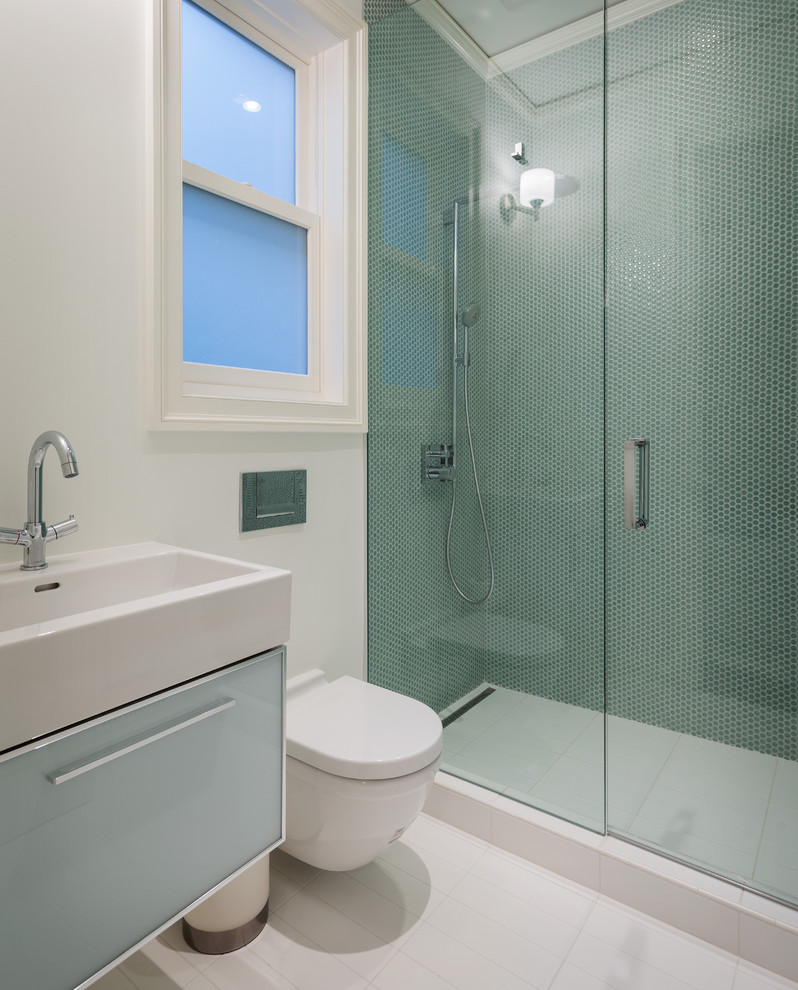 Example of a trendy blue tile and mosaic tile alcove shower design in San Francisco with an integrated sink