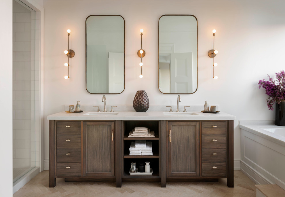 Inspiration for a transitional white tile alcove shower remodel in San Francisco with an undermount sink, dark wood cabinets, an undermount tub, white walls and recessed-panel cabinets