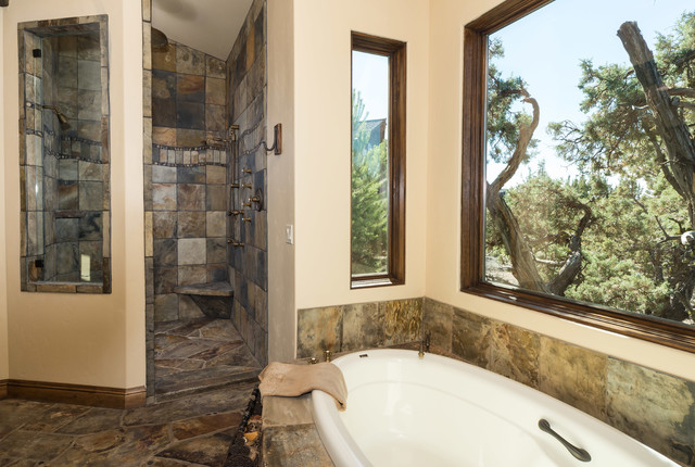 Water tower inspired home master bath suite view of shower for Masters toilet suites