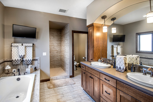 Drop-in bathtub - contemporary master beige tile and ceramic tile ceramic floor drop-in bathtub idea in Other with recessed-panel cabinets, medium tone wood cabinets and beige walls