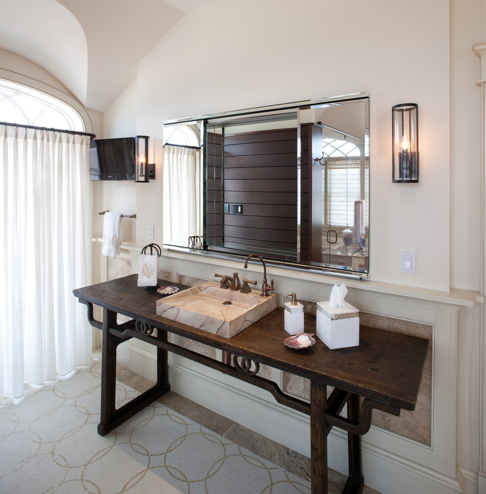 Example of a beach style bathroom design in Philadelphia with a console sink