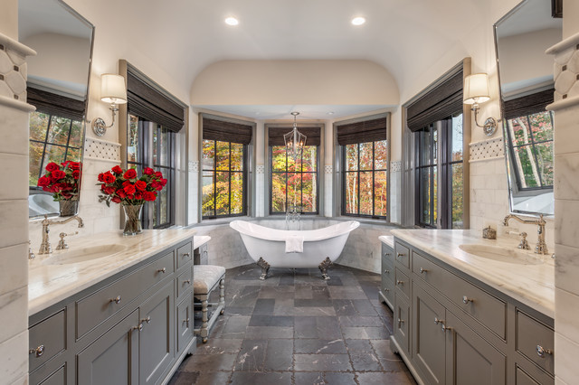 Claw-foot bathtub - large transitional master stone tile gray floor and limestone floor claw-foot bathtub idea in Other with recessed-panel cabinets, gray cabinets, white walls, an undermount sink and marble countertops