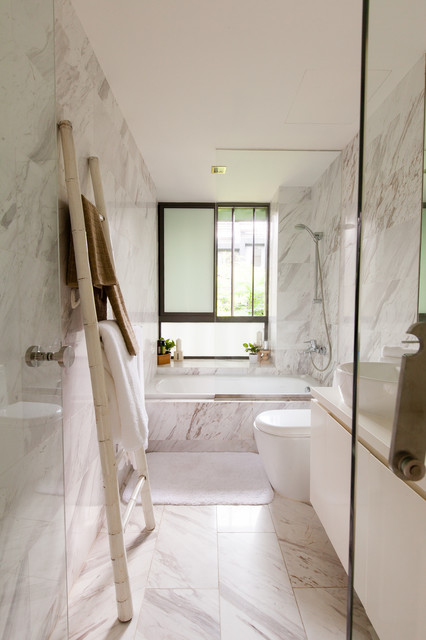 Bathroom - contemporary white tile marble floor bathroom idea in Singapore with a vessel sink, flat-panel cabinets, white cabinets, a one-piece toilet and white walls