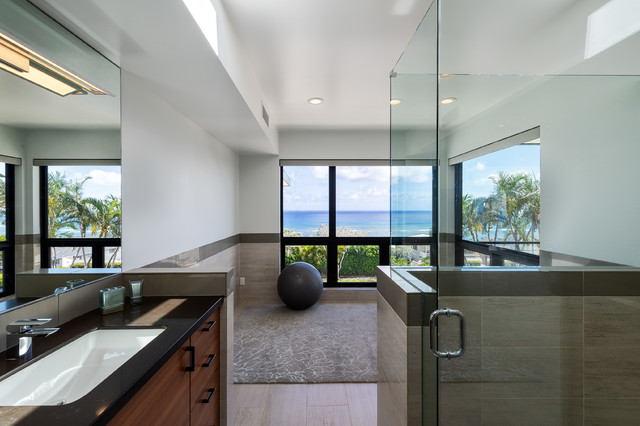 Alcove shower - large modern master porcelain tile and beige tile porcelain floor and beige floor alcove shower idea in Hawaii with an undermount sink, a hinged shower door, flat-panel cabinets, medium tone wood cabinets and granite countertops