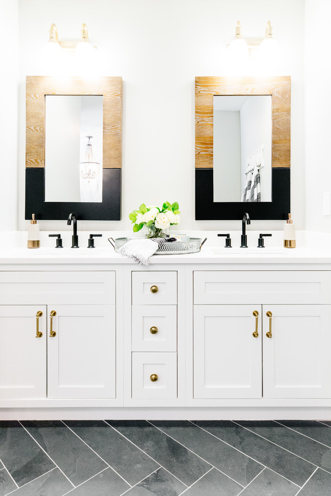Example of a large cottage master white tile and marble tile slate floor and black floor bathroom design in Phoenix with recessed-panel cabinets, white cabinets, gray walls, a drop-in sink, engineered quartz countertops and a hinged shower door