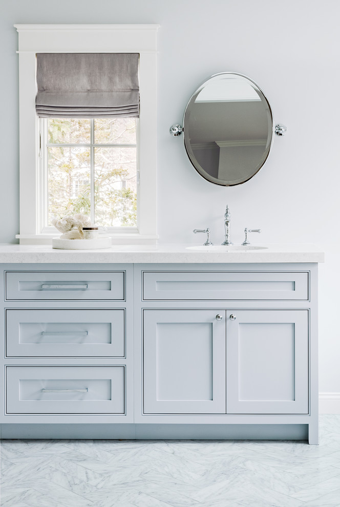 Bathroom - large traditional master marble floor bathroom idea in Boston with blue walls, quartz countertops, blue cabinets, shaker cabinets and white countertops