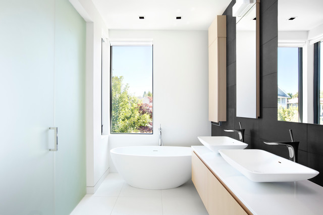 Inspiration for a small contemporary master black tile and stone tile porcelain floor bathroom remodel in Vancouver with a vessel sink, flat-panel cabinets, light wood cabinets, quartzite countertops and white walls